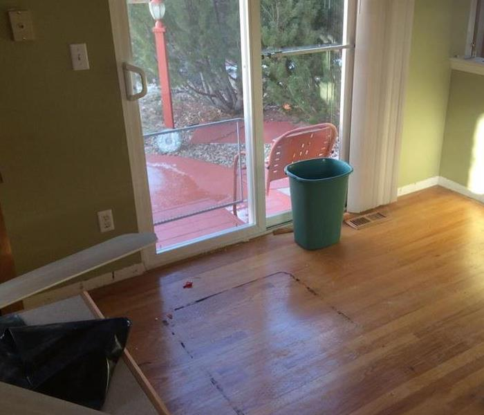 Wood flooring covered in dirt and residue.
