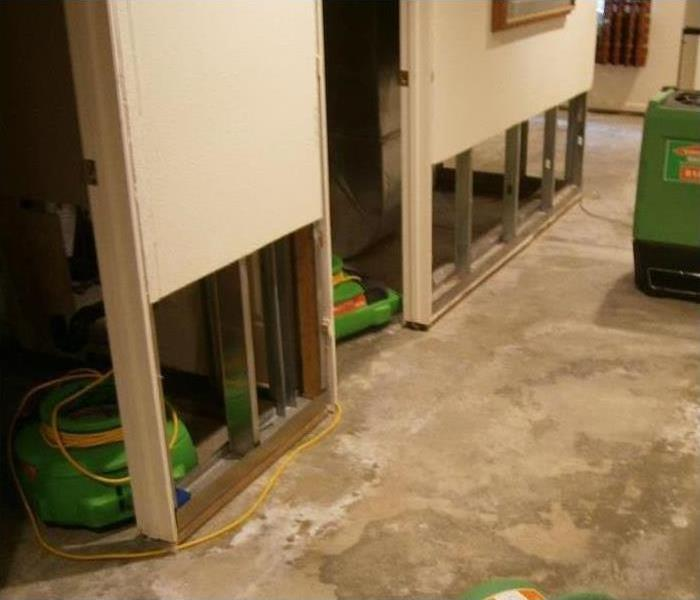 Flood cuts performed in a living room of a home and there is drying equipment