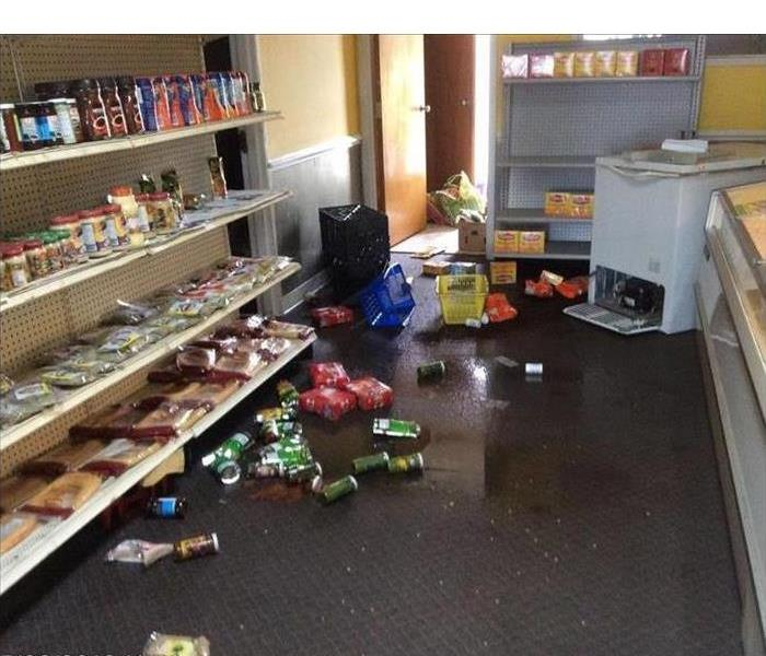 Floor wet, products of store on the floor. Concept storm damage on a store